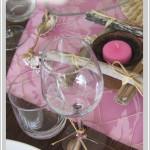 Candeline rosa e legni sbiancati dal mare